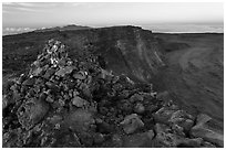 Summit cairn and crater at dusk. Hawaii Volcanoes National Park ( black and white)