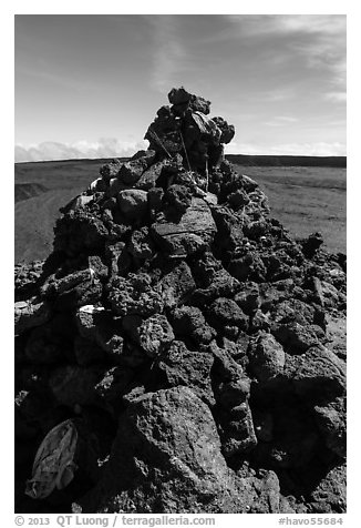 Mauna Loa summit cairn festoned with ritual offerings. Hawaii Volcanoes National Park (black and white)