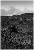 Red and orange lava, rainbow in clouds, Mauna Loa. Hawaii Volcanoes National Park, Hawaii, USA. (black and white)