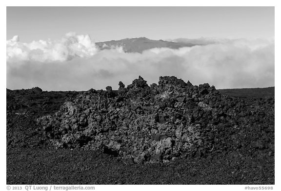 Black of colorful lava on Mauna Loa, Mauna Kea emerging from Saddle clouds. Hawaii Volcanoes National Park (black and white)