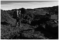 Backpacker entering park through Observatory Trail. Hawaii Volcanoes National Park, Hawaii, USA. (black and white)
