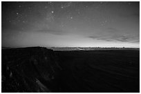 Stars, Mauna Loa summit cliffs, Mokuaweoweo crater, Halemaumau glow at dawn. Hawaii Volcanoes National Park ( black and white)