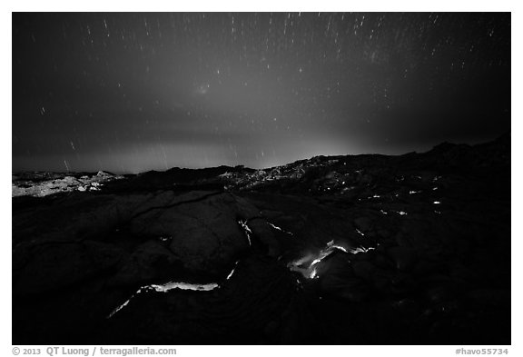 Molten lava flow with star trails. Hawaii Volcanoes National Park (black and white)