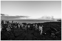 Large group of people at lava viewing area. Hawaii Volcanoes National Park ( black and white)