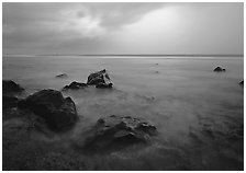 Rocks in water and approaching storm, Siu Point, Tau Island. National Park of American Samoa ( black and white)