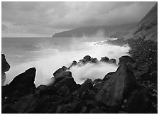 Stormy ocean and balsalt boulders, Siu Point, Tau Island. National Park of American Samoa ( black and white)