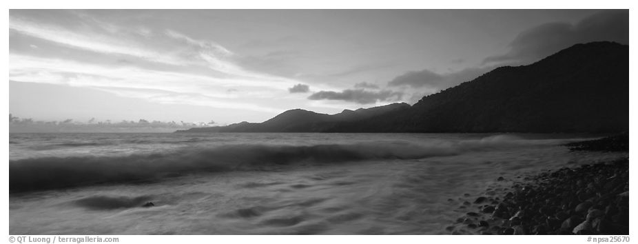 Wave and coastal hills at dawn, Tutuila Island. National Park of American Samoa (black and white)