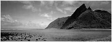 Pointed tropical peaks rising above turquoise waters, Ofu Island. National Park of American Samoa (Panoramic black and white)