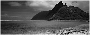 Tropical landscape with blue waters, pointed peaks, and clouds, Ofu Island. National Park of American Samoa (Panoramic black and white)