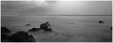Seascape with storm light. National Park of American Samoa (Panoramic black and white)