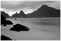 Balsalt boulders on South Beach, Sunuitao Peak and Piumafua mountain on Olosega Island in the background, Ofu Island. National Park of American Samoa ( black and white)