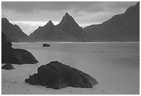 Balsalt boulders on South Beach, Sunuitao Peak in the background, Ofu Island. National Park of American Samoa (black and white)