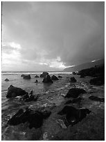 Boulders and coastline at sunrise with rainbow, Siu Point, Tau Island. National Park of American Samoa ( black and white)