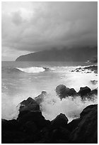Stormy seascape with crashing waves and clouds, Siu Point, Tau Island. National Park of American Samoa ( black and white)