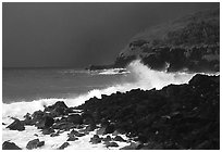 Dark boulders, crashing waves, and dark sky, storm light, Tau Island. National Park of American Samoa ( black and white)