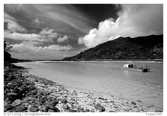 Fishing boat in Vatia Bay, mid-day, Tutuila Island. National Park of American Samoa (black and white)
