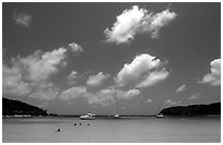 Saltpond bay beach with swimmers and boats. Virgin Islands National Park, US Virgin Islands. (black and white)