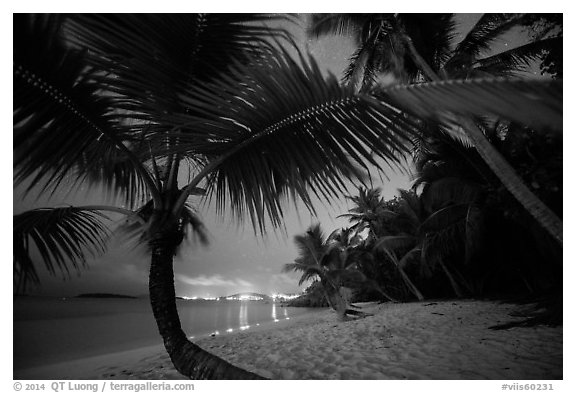 Salomon beach with distant lights at night. Virgin Islands National Park (black and white)