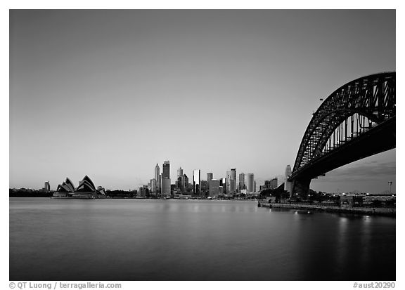 Harbor Bridge, skyline, and Opera House, dawn. Sydney, New South Wales, Australia (black and white)