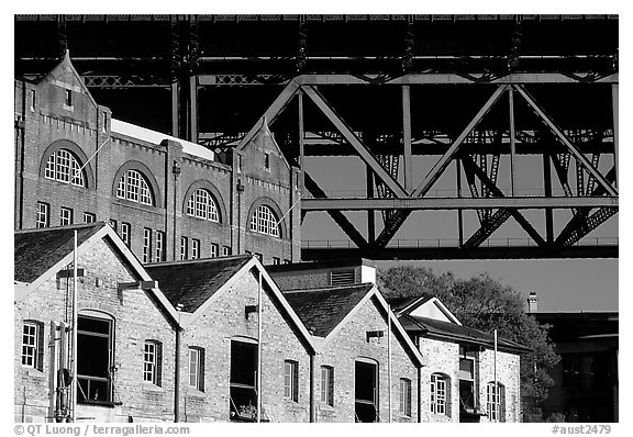Colonial-era buildings of the Rocks and Harboor bridge. Sydney, New South Wales, Australia (black and white)