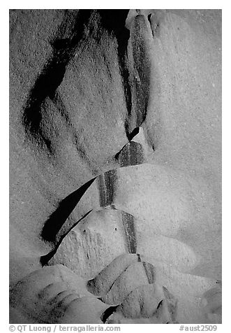 Rock sculptured by flash flood flows on Ayers Rock. Uluru-Kata Tjuta National Park, Northern Territories, Australia (black and white)
