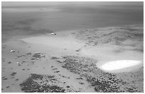Aerial view of a reef and sand bar  near Cairns. The Great Barrier Reef, Queensland, Australia (black and white)