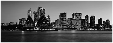 Sydney night cityscape and reflections. Sydney, New South Wales, Australia (Panoramic black and white)