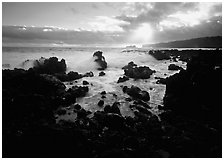 Rocks and surf at sunrise, Keanae Peninsula. Maui, Hawaii, USA (black and white)