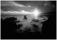 Sun shining brilliantly over primeval seascape, Kenae Peninsula. Maui, Hawaii, USA ( black and white)