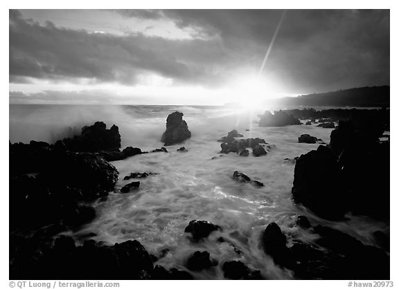 Sun and surf over rugged rocks, Kenae Peninsula. Maui, Hawaii, USA (black and white)
