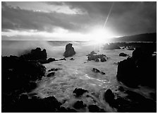 Sun and surf over rugged rocks, Kenae Peninsula. Maui, Hawaii, USA ( black and white)