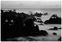 Rocks and surf, dawn, Keanae Peninsula. Maui, Hawaii, USA (black and white)