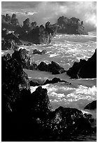 Sharp volcanic Rocks and surf, Keanae Peninsula. Maui, Hawaii, USA (black and white)