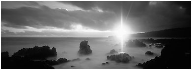 Seascape with mystic sun and rays. Maui, Hawaii, USA (Panoramic black and white)