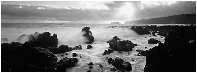 Seascape with jagged rocks and surf. Maui, Hawaii, USA (Panoramic black and white)