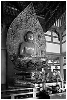 Amida seated on a lotus flower, the largest Buddha statue carved in over 900 years, Byodo-In Temple. Oahu island, Hawaii, USA (black and white)