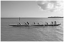 Outrigger canoe, Maunalua Bay, late afternoon. Oahu island, Hawaii, USA (black and white)