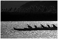 Backlit outrigger canoe, Maunalua Bay, late afternoon. Oahu island, Hawaii, USA (black and white)
