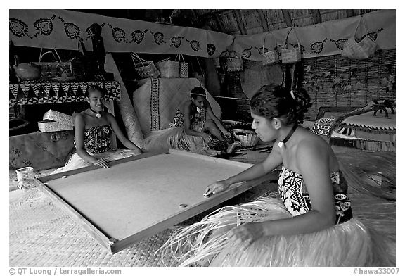Fiji women playing at a traditional pool table in vale ni bose house. Polynesian Cultural Center, Oahu island, Hawaii, USA (black and white)