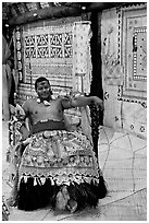 Fiji tribal chief inside vale levu (chief) house. Polynesian Cultural Center, Oahu island, Hawaii, USA ( black and white)
