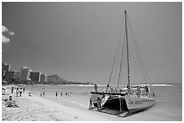 Catamaran and Waikiki Beach. Waikiki, Honolulu, Oahu island, Hawaii, USA ( black and white)