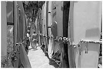 Racks of surfboards. Waikiki, Honolulu, Oahu island, Hawaii, USA ( black and white)