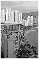 High rise hotels and beach seen from the Sheraton glass elevator, late afternoon. Waikiki, Honolulu, Oahu island, Hawaii, USA (black and white)
