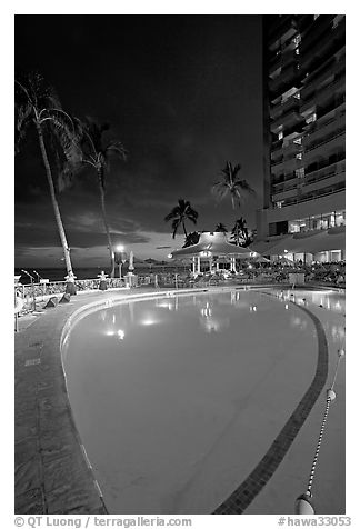 Swimming pool at night, with dance performance, Sheraton hotel. Waikiki, Honolulu, Oahu island, Hawaii, USA