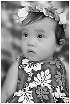 Baby girl in hawaiian dress wearing a flower lei on her head. Waikiki, Honolulu, Oahu island, Hawaii, USA ( black and white)