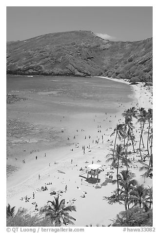 Hanauma Bay beach with people. Oahu island, Hawaii, USA (black and white)