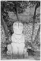 Marquesas statue and walls. Polynesian Cultural Center, Oahu island, Hawaii, USA ( black and white)
