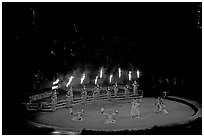 Wedding procession led by torch bearers performed by Tahitian dancers. Polynesian Cultural Center, Oahu island, Hawaii, USA ( black and white)