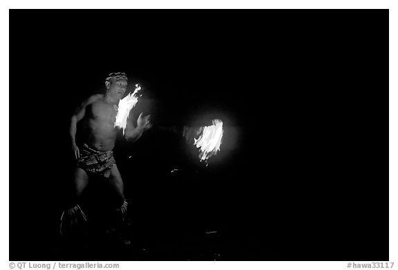 Traditional Samoan fireknife dance. Polynesian Cultural Center, Oahu island, Hawaii, USA (black and white)