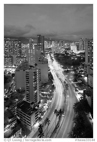 Boulevard and high rise buildings at dusk. Waikiki, Honolulu, Oahu island, Hawaii, USA (black and white)